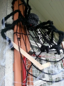 Spider Mama in my Halloween display playing hockey with her babies.