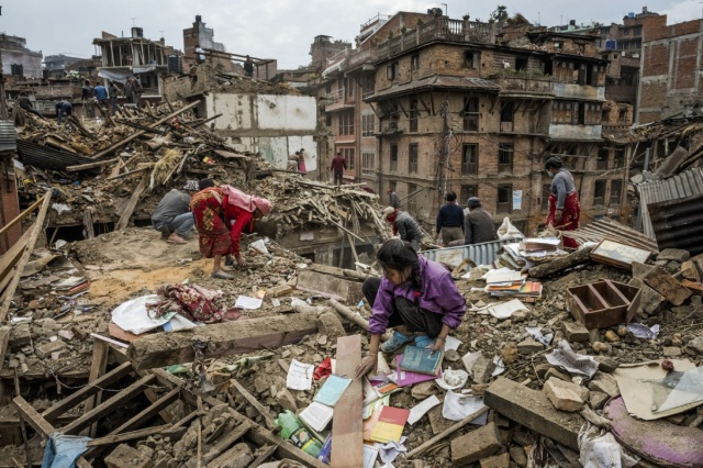Residents look for personal belongings amidst the rubble of their homes in Bhaktapur.